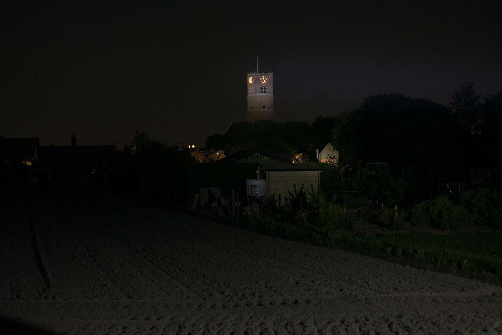 beamshots at night with tower