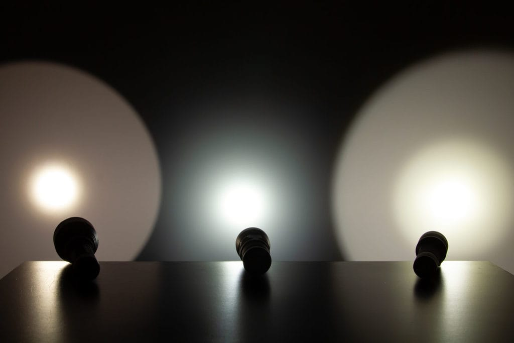 3 flashlight beams on wall