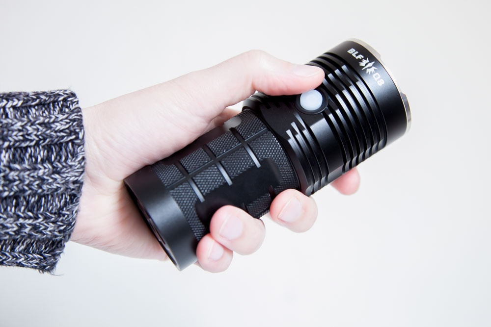 holding the blf q8 flashlight in hand