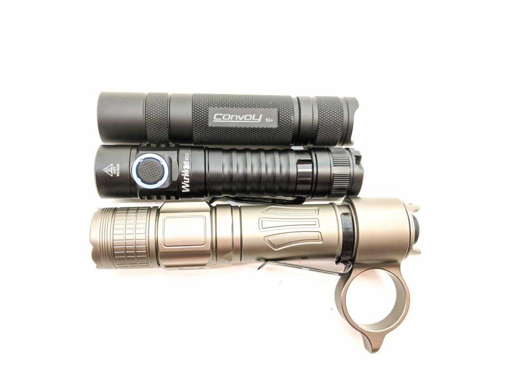 Brinyte PT18 PRO next to 2 other flashlights