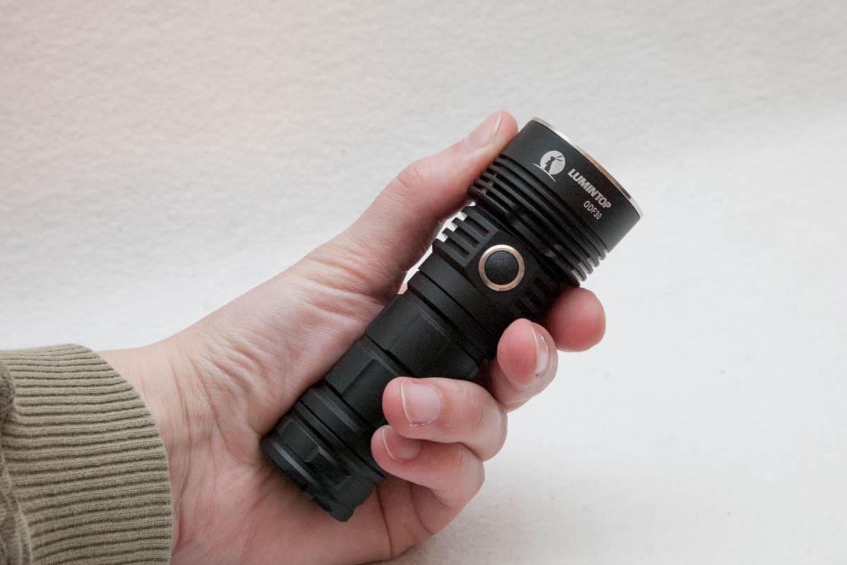 holding ODF flashlight in hand