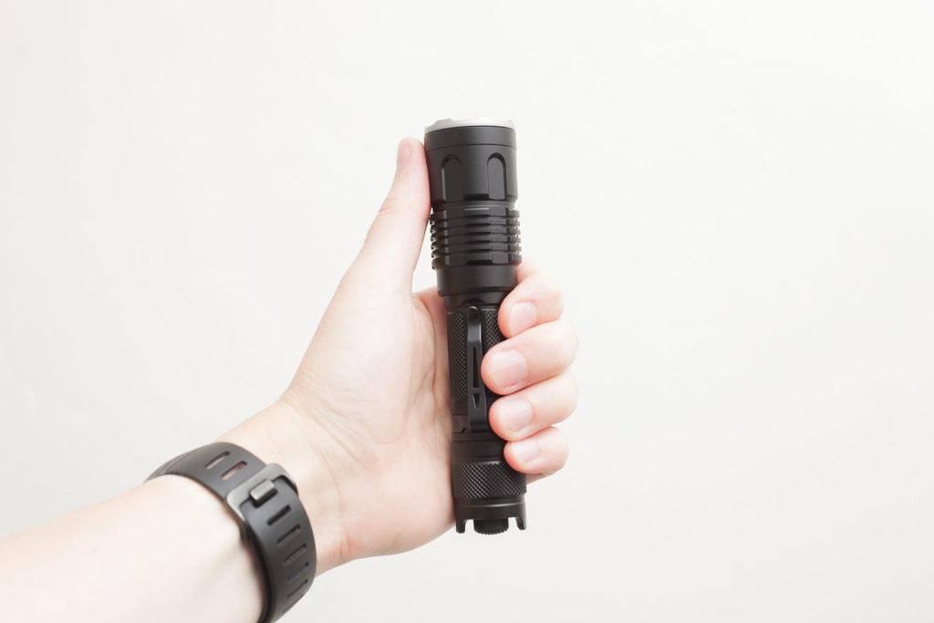 Jetbeam flashlight holding in hand