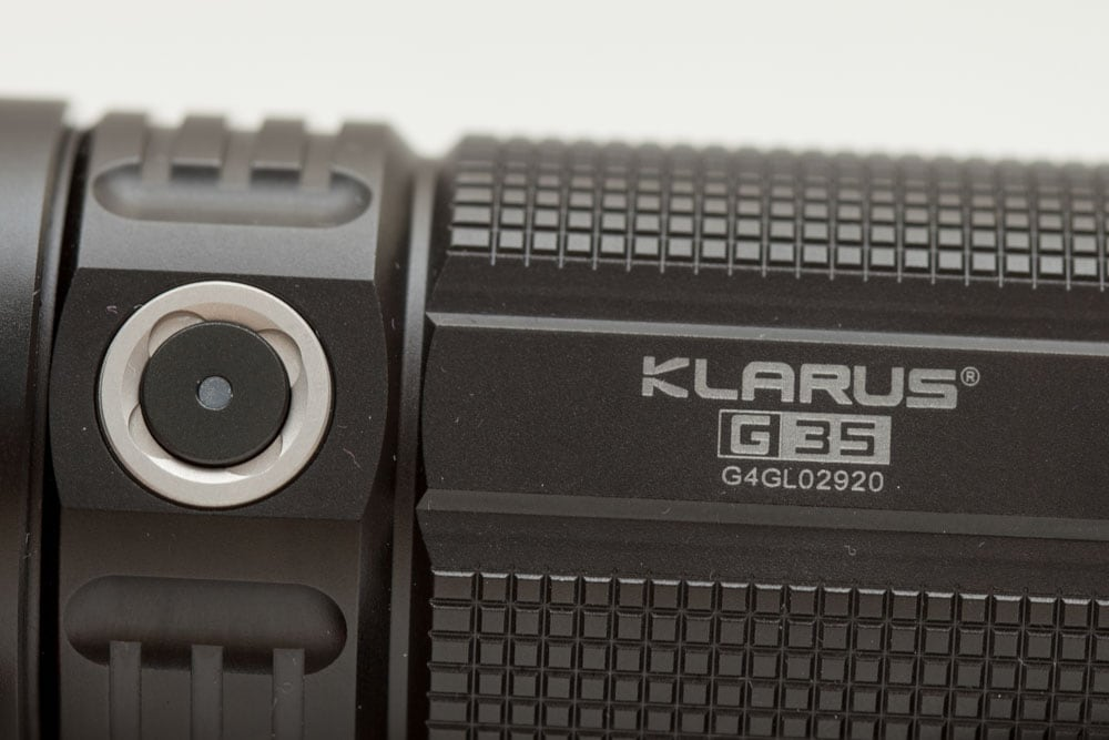 close up of klarus engraving and side switch