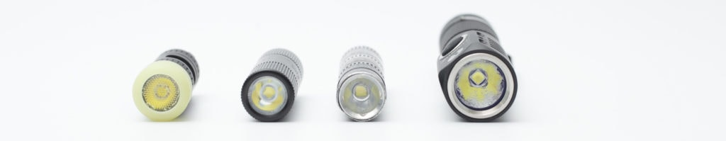 4 tiny flashlights on a row