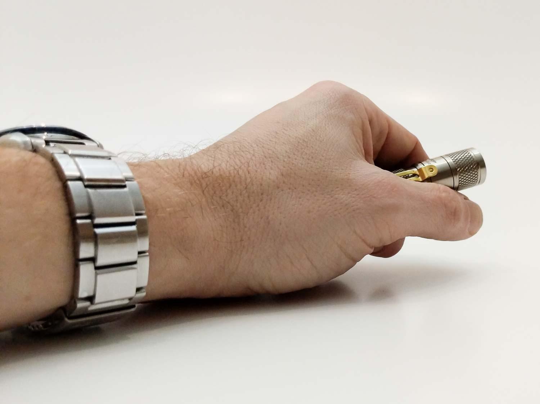 lumintop tool titanium in hand