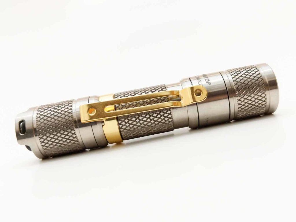 side view of lumintop aa titanium on white background