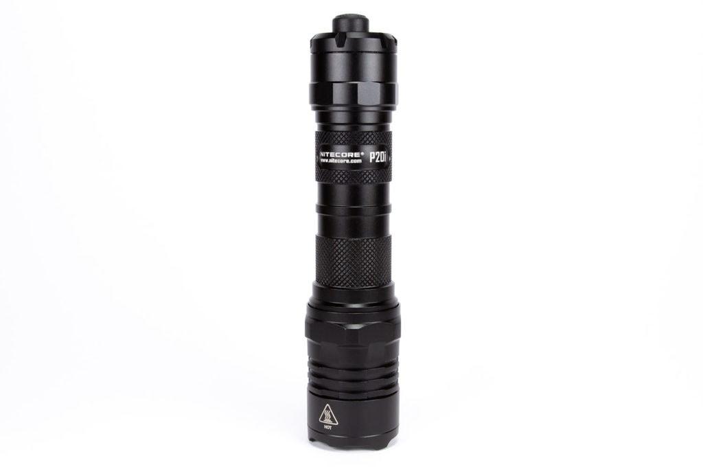 side view of black flashlight on white background 4