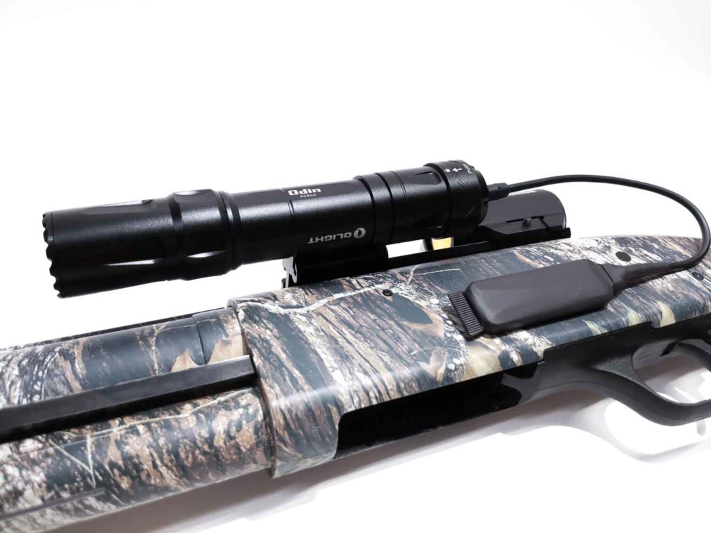 Olight Odin flashlight on shotgun