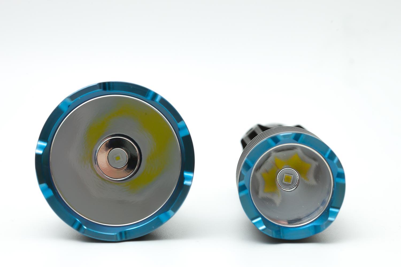 2 blue flashlight bezels