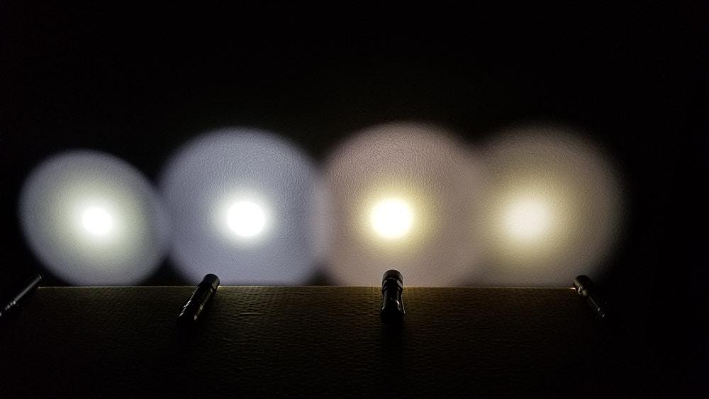 4 flashlights shining on a wall