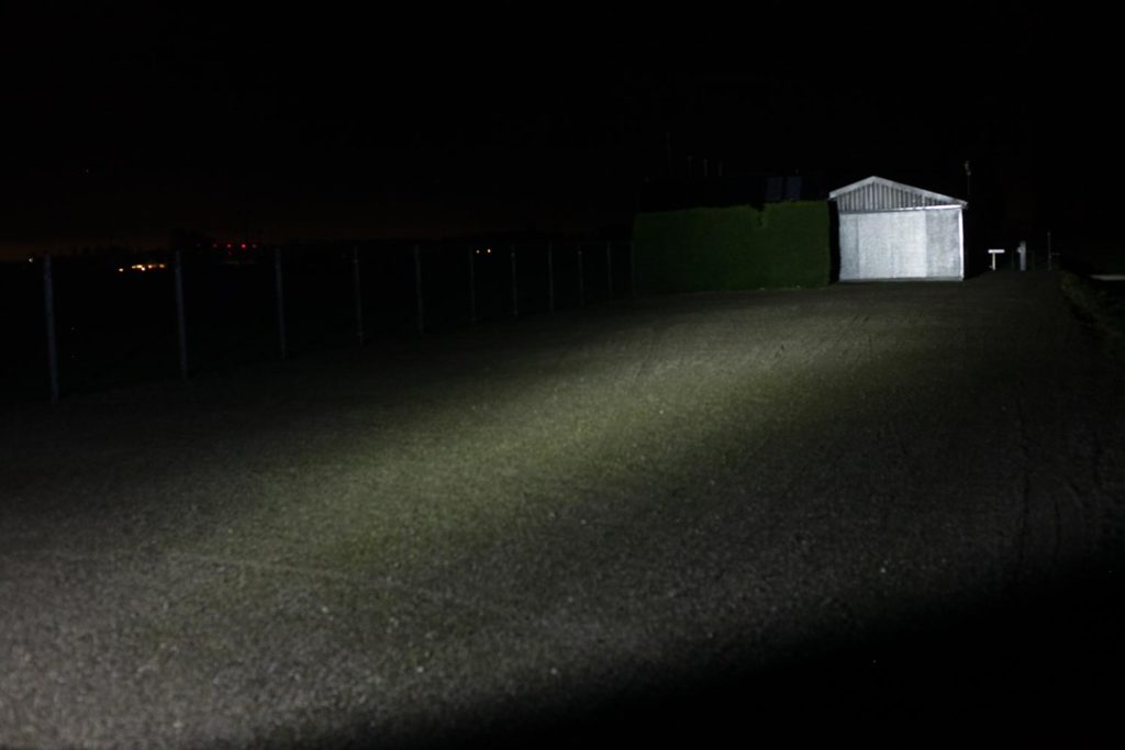 beamshot at night with shed