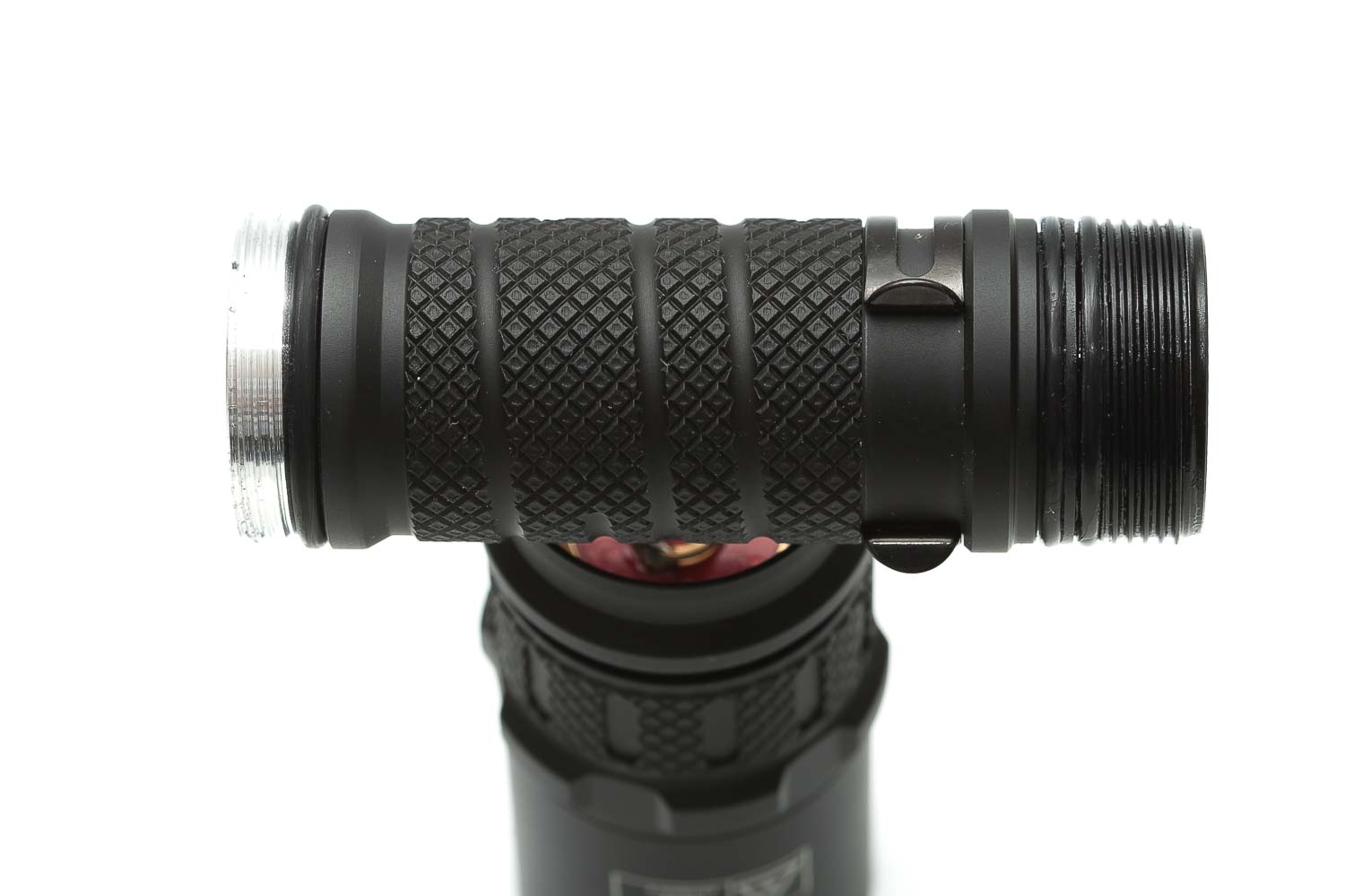 close up of flashlight knurling